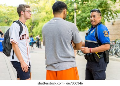 AUSTIN - CIRCA OCTOBER 2015: Police officers from the University of Texas police department talk to students about the dangers of drinking and driving and alcohol education outside on a sunny day.