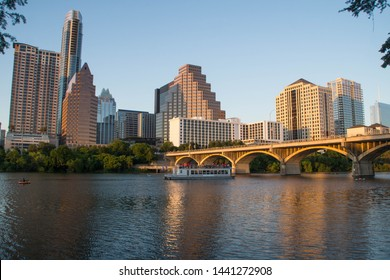 Austin skyline over Colorado river at sunset, Texas.