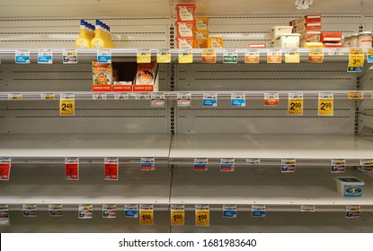 Austin, Texas - 22 March 2020: almost empty refrigerated dairy shelves during the panic due to the Coronavirus