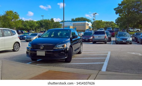 Austin, Texas - 29 August 2017: a poorly and illegally parked VW sedan