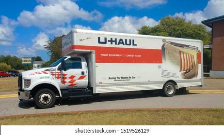 Austin, Texas - 29 September 2019: a U-Haul truck parked next to a brick building