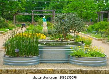 AUSTIN, TEXAS - APRIL 3, 2018 - The Theme Gardens and JJ Priour sculpture at Lady Bird Johnson Wildflower Center in Austin, Texas