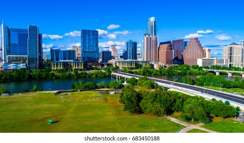 Austin Texas Auditorium Shores park during summertime sunny day skyline cityscape capital city downtown view from aerial drone near 1st street bridge