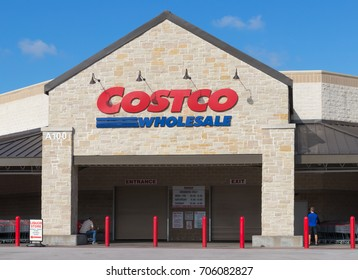 AUSTIN, TEXAS - AUGUST 29 2017: Costco store just before opening with two men already waiting
