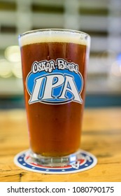 AUSTIN, TEXAS - CIRCA DECEMBER 2017: A cold foamy beer is enjoyed in a pint glass at the Oskar Blues Brewery in north Austin, Texas.