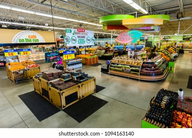 AUSTIN, TEXAS - CIRCA MARCH 2017: An HEB produce department sells fresh fruits, vegetables, and juices in a grocery store in Austin, Texas.