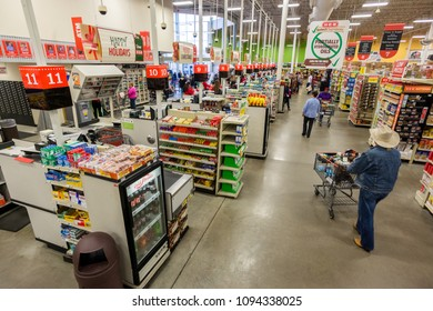 AUSTIN, TEXAS - CIRCA MARCH 2017: Customers with baskets of groceries check out at cash registers at an HEB grocery store in Austin, Texas.