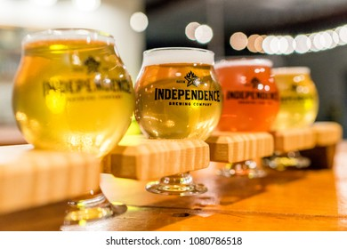 AUSTIN, TEXAS - CIRCA NOVEMBER 2017: A cold foamy beer flight and sampler is enjoyed in small pint glasses at the Independence Brewing Co. in Austin, Texas.