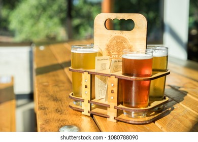 AUSTIN, TEXAS - CIRCA NOVEMBER 2017: A cold foamy beer flight and sampler is enjoyed in small pint glasses at the Live Oak brewery in south east Austin, Texas.