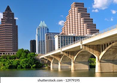 Austin Texas cityscape with Colorado River on bright sunny day