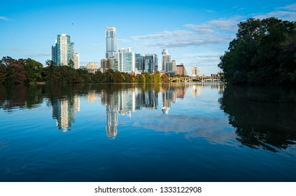 Austin Texas downtown skyline cityscape mirrored reflections tranquil water reflection on Town Lake or Lady Bird Lake