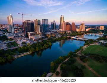 Austin Texas Dramatic Colorful Sunset over Auditorium Shores on Town Lake during perfect Golden Hour reflecting off Skyline Cityscape Texas State Capital