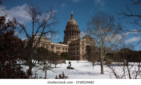 Austin, Texas - February 15, 2021: Fresh snow covers the state capitol lawn after a winter storm