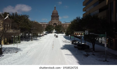 Austin, Texas - February 15, 2021: Snow covers Congress Avenue near the state capitol after a winter storm
