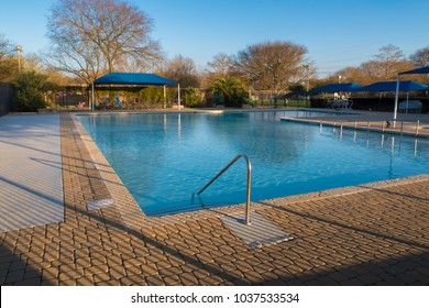 AUSTIN, TEXAS - FEBRUARY 25 2018: a neighborhood park pool waiting for opening in the spring