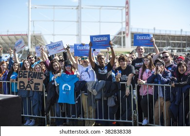 AUSTIN, TEXAS - FEBRUARY 27, 2016: An excited crowd of Bernie Sanders supporters wave signs while awaiting the candidate's arrival for a campaign rally at the Circuit of the Americas.