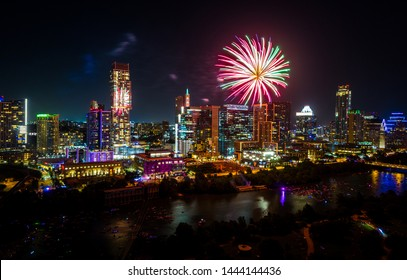 Austin Texas Fireworks display explosions of Colors in the sky above Town Lake and the Downtown Skyline Cityscape of the Largest Fireworks display in Texas