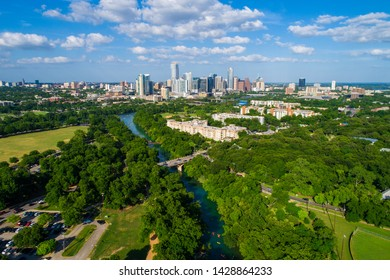 Austin Texas Green landscape Barton Creek river flowing into the Colorado River with Skyline Cityscape far in the background Summer nature meets city