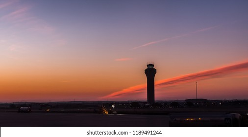 Austin, Texas - January 3, 2018: The air traffic control tower can be seen with a picturesque morning sky at Austin-Bergstrom International Airport.