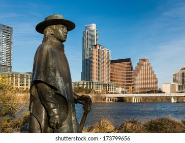 AUSTIN, TEXAS - JANUARY 5: Stevie Ray Vaughan statue in front of downtown Austin and the Colorado River from Auditorium Shores on January 5, 2014 in Austin, Texas