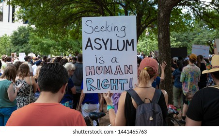AUSTIN, TEXAS - JULY 2, 2019 - People protesting against President Donald Trump and border camps. Different demands written on placards.