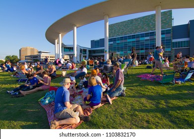 AUSTIN, TEXAS - JUNE 1 2014: The Long Center lawn is the perfect place to sit or lounge d;uring an outdoor concert