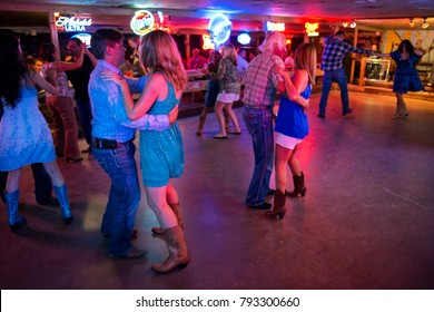 Austin, Texas - June 13, 2014: People dancing country music in the Broken Spoke dance hall in Austin, Texas, USA