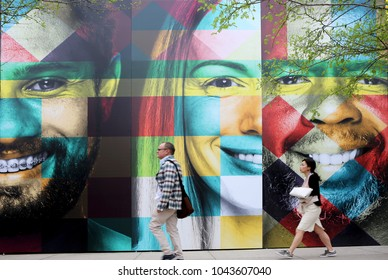AUSTIN, TEXAS - MAR 11, 2018: SXSW South by Southwest Annual music, film, and interactive conference and festival in Austin, Texas. Wall painted with colorful faces, symbolic for SXSW.
