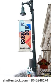 AUSTIN, TEXAS - MAR 11, 2018: SXSW South by Southwest Annual music, film, and interactive conference and festival. Lamp post with SXSW sign at 6th street