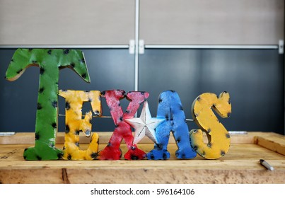 AUSTIN, TEXAS - MAR 8, 2017: SXSW  South by Southwest  Annual music, film, and interactive conference and festival in Austin, Texas. Colorful rustic handmade TEXAS sign.