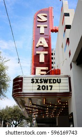 AUSTIN, TEXAS - MAR 8, 2017: SXSW  South by Southwest  Annual music, film, and interactive conference and festival in Austin, Texas. Paramount theater with SXSW advertisement,