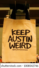"""AUSTIN, TEXAS - MAR 9, 2012: SXSW, South by Southwest Annual music, film, and interactive conference and festival.Popular shopping bag with sign """" Keep Austin Weird"""""""
