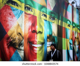 AUSTIN, TEXAS - MARCH 11, 2018: SXSW South by Southwest Annual music, film, and interactive conference and festival in Austin, Texas. Wall painted with colorful faces, symbolic for SXSW.