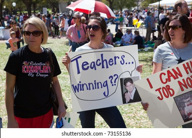 "AUSTIN, TEXAS - MARCH 12: Several unidentified protesters invoked Charlie Sheen's image and catchphrases as well as other internet memes on their protest signs at the ""Save Texas Schools Rally"" on March 12th, 2011 in Austin, Texas."