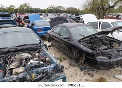 AUSTIN, TEXAS â?? MARCH 16 2016: pretty clean black Ford car for being in a junkyard