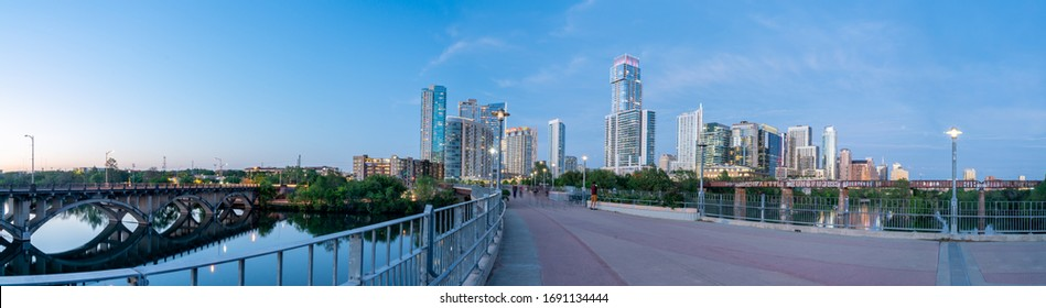 Austin, Texas - March 28, 2020: A View of Downtown Austin Skyline from the Walkway Bridge At Dusk