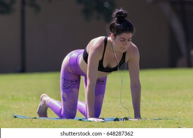 AUSTIN, TEXAS - MAY 24 2017: a young woman in the yoga tabletop pose