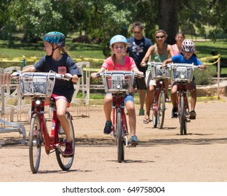 AUSTIN, TEXAS - MAY 25 2017: a group of children on bikes in the park