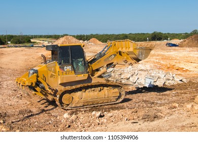 AUSTIN, TEXAS - MAY 29 2018: a Caterpillar D973D track loader clearing land for a new hiway
