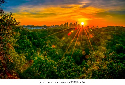 Austin Texas nature trail hiking at sunrise with golden hour sunburst glowing over the city skyline cityscape amazing fine arts photography
