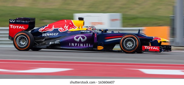 AUSTIN, TEXAS - NOVEMBER 16.  Sebastian Vettel of Infiniti Red Bull Racing in the Formula One Qualifying Session at the Circuit of The America's race track on November 16, 2013 in Austin, Texas.
