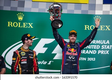 AUSTIN, TEXAS - NOVEMBER 17.  Winner Sebastian Vettel holding up his trophy on the podeum after the Formula 1 United States Grand Prix on November 17, 2013 in Austin, Texas.