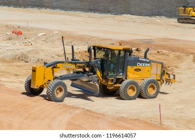AUSTIN, TEXAS - OCTOBER 4 2018: A Deere 770GP Motor Grader preparing to move on to the next mound of dirt.