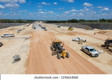 AUSTIN, TEXAS - OCTOBER 4 2018: several pickup trucks and 4 wheeled road building vehicles
