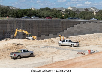 AUSTIN, TEXAS - OCTOBER 4 2018: trucks and yellow excavators working on a new highway