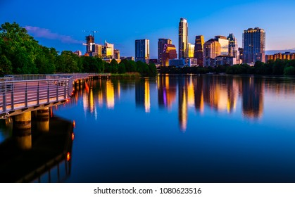 Austin Texas perfect mirrored reflection Cityscape Skyline View of the Spring time April 2018 capital city downtown Riverside pedestrian bridge at Dawn before sunrise like glass symmetry