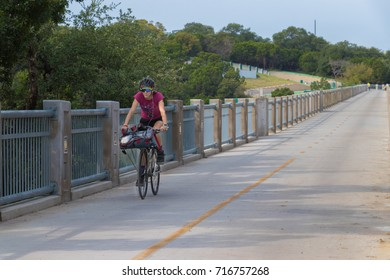 AUSTIN, TEXAS - SEPTEMBER 13 2017: a woman cyclist enjoying a downward stretch of her ride