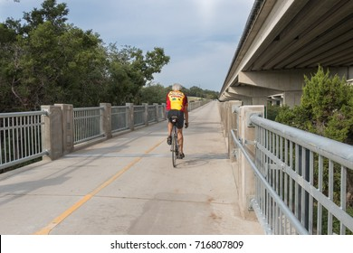 AUSTIN, TEXAS - SEPTEMBER 13 2017: just starting his ascent up a bike pedestrian bridge