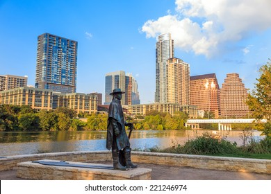 AUSTIN, TEXAS - SEPTEMBER 27: Stevie Ray Vaughan statue in front of downtown Austin and the Colorado River from Auditorium Shores on September 27, 2014 in Austin, Texas