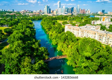 Austin Texas skyline cityscape aerial drone view above green landscape Barton creek flowing into town lake